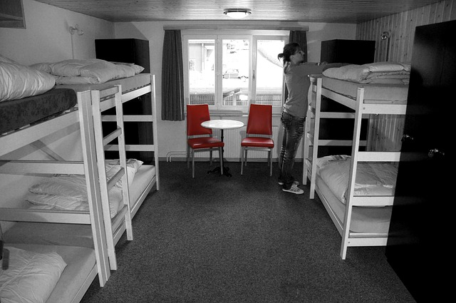 Hostel dorm room with two red chairs