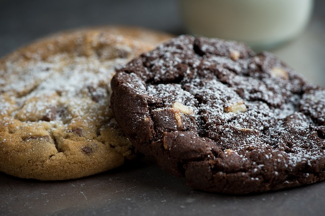 Two chocolate chip cookies, one dark brown, one light brown