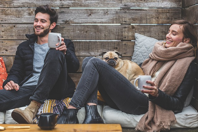 Stylish couple lounging with their dog