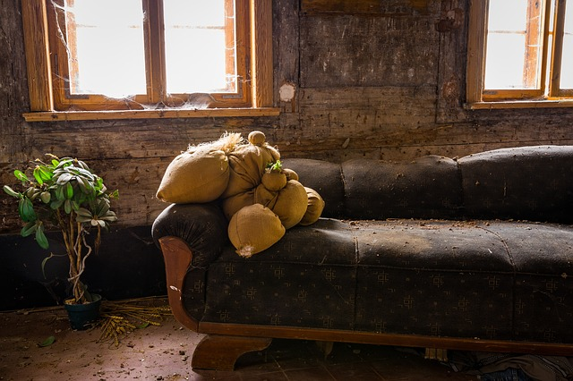 Dirty sofa in a dirty room
